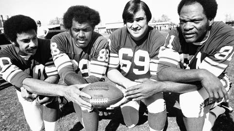 "<p>               FILE - This Jan. 9, 1975, file photo shows from left, Minnesota Vikings defensemen  Jim Marshall, Alan Page, Doug Sutherland and Carl Eller. ""Purple People Eaters"" _ The bruising Minnesota Vikings defensive line from the late 1960s through the 1970s. Members included Hall of Famer Alan Page, Carl Eller and Jim Marshall. If not for going 0-4 in Super Bowls, the group likely would be more celebrated. (AP Photo/File)             </p>"