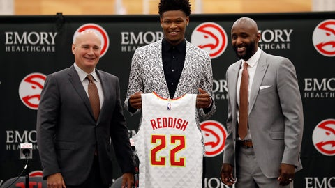 <p>               Atlanta Hawks first-round NBA basketball draft pick Cam Reddish of Duke holds his jersey as he poses with general manager Travis Schlenk, left, and head coach Lloyd Pierce during a news conference Monday, June 24, 2019, in Atlanta. (AP Photo/John Bazemore)             </p>