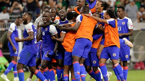 <p>               Haiti celebrates a 3-2 win over Canada in a CONCACAF Gold Cup soccer quarterfinal Saturday, June 29, 2019, in Houston. (AP Photo/Michael Wyke)             </p>
