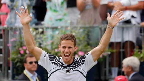 <p>               Diego Schwartzman of Argentina celebrates winning the singles match against Marin Cilic of Croatia at the Queens Club tennis tournament in London, Thursday, June 20, 2019. (AP Photo/Frank Augstein)             </p>