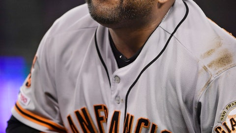 <p>               San Francisco Giants third baseman Pablo Sandoval winces after having his hand stepped on while forcing out Los Angeles Dodgers' Max Muncy during the fifth inning of a baseball game, Monday, June 17, 2019, in Los Angeles. (AP Photo/Mark J. Terrill)             </p>