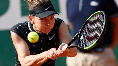 <p>               Romania's Simona Halep plays a shot against Poland's Iga Swiatek during their fourth round match of the French Open tennis tournament at the Roland Garros stadium in Paris, Monday, June 3, 2019. (AP Photo/Christophe Ena)             </p>