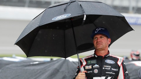 <p>               Clint Bowyer stands on pit row waiting out the rain delay during the NASCAR cup series auto race at Michigan International Speedway, Sunday, June 9, 2019, in Brooklyn, Mich. (AP Photo/Carlos Osorio)             </p>