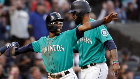 <p>               Seattle Mariners' Shed Long, left, heads to the dugout with Domingo Santana after the two scored against the Houston Astros, and points to first base to acknowledge the single of Mallex Smith that scored the two in the fifth inning of a baseball game Wednesday, June 5, 2019, in Seattle. (AP Photo/Elaine Thompson)             </p>