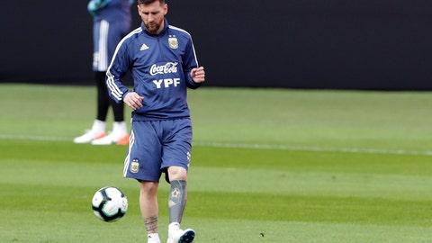 <p>               Argentina's Lionel Messi takes part in a practice session in Porto Alegre, Brazil, Friday, June 21, 2019. Argentina will face Qatar on June 23 in a Copa America Group B soccer match. (AP Photo/Silvia Izquierdo)             </p>