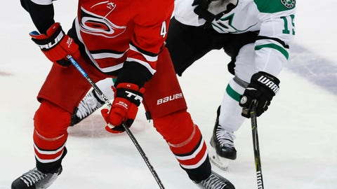 <p>               FILE - In this Feb. 23, 2019, file photo, Carolina Hurricanes defenseman Calvin de Haan (44) controls the puck next to Dallas Stars left wing Blake Comeau (15) during the third period of an NHL hockey game in Dallas. The Chicago Blackhawks have acquired de Haan in a trade with the Hurricanes. The Blackhawks also received minor league forward Aleksi Saarela from the Hurricanes in exchange for defenseman Gustav Forsling and goaltender Anton Forsberg. (AP Photo/LM Otero, File)             </p>