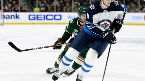 <p>               FILE - In this April 2, 2019, file photo, Winnipeg Jets defenseman Jacob Trouba (8) has the puck while shorthanded against Minnesota Wild center Luke Kunin (19) during the second period of an NHL hockey game in St. Paul, Minn. The New York Rangers have acquired Trouba from the Jets for defenseman Neal Pionk and the 20th overall pick in the draft. The teams announced the trade Monday, June 17, 2019. (AP Photo/Hannah Foslien, File)             </p>