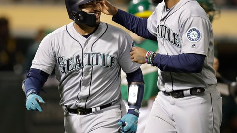 <p>               Seattle Mariners' Omar Narvaez, left, celebrates with Domingo Santana after hitting a two-run home run off Oakland Athletics' Wei-Chung Wang during the seventh inning of a baseball game Friday, June 14, 2019, in Oakland, Calif. (AP Photo/Ben Margot)             </p>