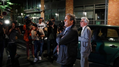 <p>               Michel Platini and his lawyer William Bourdon, right, answer reporters after Platini has been freed, outside the French police anti-corruption and financial crimes office in Nanterre, outside Paris, early Wednesday, June 19, 2019. Former UEFA president Michel Platini proclaimed his innocence during police questioning Tuesday following his arrest as part of a corruption probe into the vote that gave the 2022 World Cup to Qatar. (AP Photo/ Francois Mori)             </p>