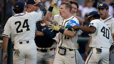 <p>               Michigan's Jimmy Kerr, center, is congratulated after hitting a 2-run home run against Vanderbilt during the seventh inning in Game 1 of the NCAA College World Series baseball finals in Omaha, Neb., Monday, June 24, 2019. (AP Photo/Nati Harnik)             </p>