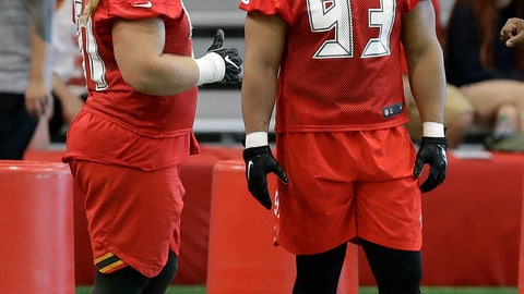 <p>               Tampa Bay Buccaneers nose tackle Ndamukong Suh (93) talks to defensive tackle Beau Allen (91) before the start of an NFL football minicamp Tuesday, June 4, 2019, in Tampa, Fla. (AP Photo/Chris O'Meara)             </p>
