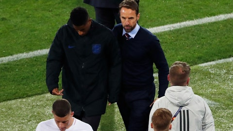 <p>               England manager Gareth Southgate, right, and England's Marcus Rashford, , center left, leave the pitch at the end of the UEFA Nations League semifinal soccer match between Netherlands and England at the D. Afonso Henriques stadium in Guimaraes, Portugal, Thursday, June 6, 2019. (AP Photo/Armando Franca)             </p>