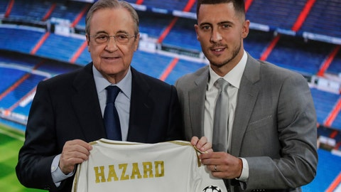 <p>               Belgium forward Eden Hazard, right, holds his new shirt with Real Madrid's President Florentino Perez during his official presentation after signing for Real Madrid at the Santiago Bernabeu stadium in Madrid, Spain, Thursday, June 13, 2019. Madrid announced last week that it had acquired the 28-year-old Belgian playmaker from Chelsea for a reported fee of around 100 million euros ($113 million) plus variables, making him the club's most expensive signing ever. (AP Photo/Manu Fernandez)             </p>