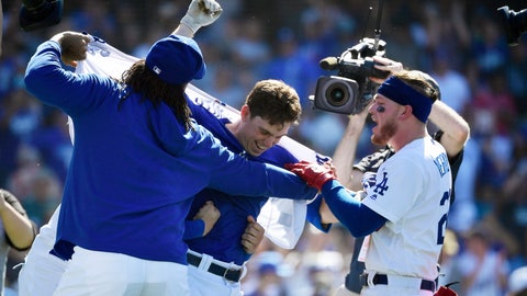 <p>               Los Angeles Dodgers' Will Smith, center, has his shirt ripped off by Kenley Jansen, left, and Alex Verdugo after hitting a two-run walkoff home run during the ninth inning of a baseball game against the Colorado Rockies, Sunday, June 23, 2019, in Los Angeles. (AP Photo/Mark J. Terrill)             </p>