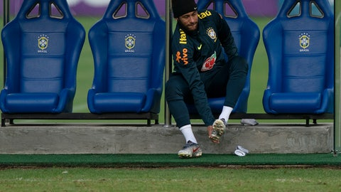 <p>               Brazil's Neymar puts on his cleats during a practice session of the national soccer team at the Granja Comary training center ahead the Copa America tournament in Teresopolis, Brazil, Tuesday, June 4, 2019. (AP Photo/Leo Correa)             </p>