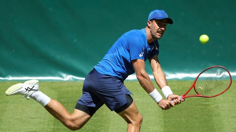 <p>               Steve Johnson from United States returns the ball to Germany's Philipp Kohlschreiber during their first round mat at the ATP tennis tournament in Halle Westphalia, Germany, Monday, June 17, 2019. (Friso Gentsch/dpa via AP)             </p>