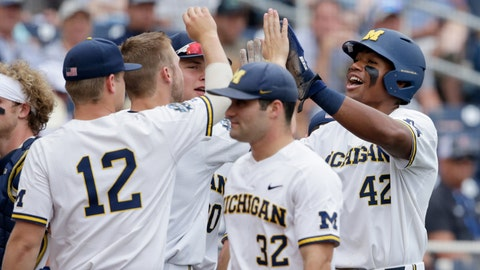 <p>               Michigan's Jordan Nwogu (42) celebrates after scoring against Texas Tech on a sacrifice fly by Jordan Brewer, in the first inning of an NCAA College World Series baseball game in Omaha, Neb., Saturday, June 15, 2019. (AP Photo/Nati Harnik)             </p>