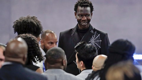<p>               Oregon's Bol Bol smiles before the NBA basketball draft Thursday, June 20, 2019, in New York. (AP Photo/Julio Cortez)             </p>