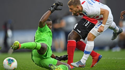<p>               Trinidad and Tobago goalkeeper Marvin Phillip deflects the ball after a shot by U.S. forward Paul Arriola during the first half of a CONCACAF Gold Cup soccer match Saturday, June 22, 2019, in Cleveland. (AP Photo/David Dermer)             </p>