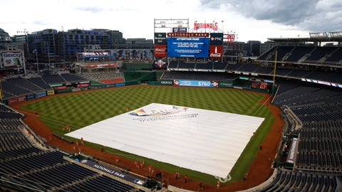 <p>               A tarp covers the infield during a rain delay before a baseball game between the Philadelphia Phillies and the Washington Nationals, Tuesday, June 18, 2019, in Washington. (AP Photo/Patrick Semansky)             </p>