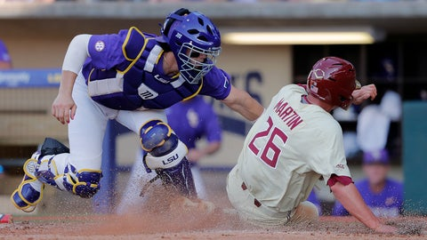 <p>               Florida State's Robby Martin (26) scores on a fielding error by LSU catcher Saul Garza, left, in the second inning of Game 2 of the NCAA college baseball super regional tournament in Baton Rouge, La., Sunday, June 9, 2019. (AP Photo/Gerald Herbert)             </p>