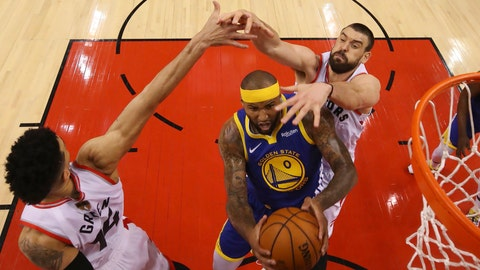 <p>               Golden State Warriors center DeMarcus Cousins (0) drives to the net between Toronto Raptors guard Danny Green (14), left, and center Marc Gasol (33) during the first half of Game 5 of the NBA Finals basketball game in Toronto on Monday, June 10, 2019. (Gregory Shamus/Pool Photo via AP, Pool)             </p>