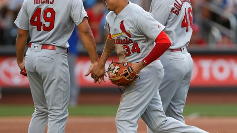 <p>               St. Louis Cardinals shortstop Yairo Munoz (34) celebrates with relief pitcher Jordan Hicks (49) and first baseman Paul Goldschmidt, right, after the Cardinals defeated the New York Mets 5-4 in the 10th inning of a baseball game Friday, June 14, 2019, in New York, that had been suspended Thursday because of rain. (AP Photo/Kathy Willens)             </p>