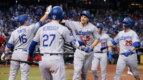 <p>               Los Angeles Dodgers' Corey Seager (5) celebrates with Will Smith (16), Alex Verdugo (27), Justin Turner (10), and David Freese (25) after hitting a three-run home run against the Arizona Diamondbacks in the fourth inning during a baseball game, Monday, June 3, 2019, in Phoenix. (AP Photo/Rick Scuteri)             </p>
