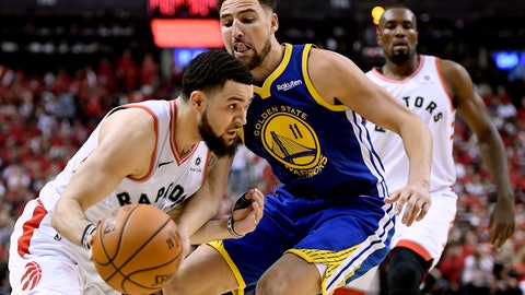 <p>               Toronto Raptors guard Fred VanVleet (23) moves the ball around Golden State Warriors guard Klay Thompson (11) during the second half of Game 2 of basketball's NBA Finals, Sunday, June 2, 2019, in Toronto. (Frank Gunn/The Canadian Press via AP)             </p>