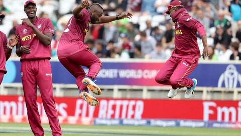 <p>               West Indies' bowler Andre Russell, second from right, celebrates with Darren Bravo taking the wicket of Pakistan's Haris Sohail as West Indies' captain Jason Holder, left, smiles during a Cricket World Cup match at Trent Bridge cricket ground in Nottingham, England, Friday, May 31, 2019. (AP Photo/Rui Vieira)             </p>