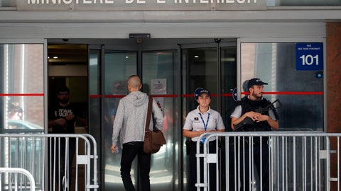 <p>               Police officers guard the Anti-Corruption Office of the Judicial Police headquarters in Nanterre, outside Paris,Tuesday, June 18, 2019. Former UEFA president Michel Platini has been arrested in relation to a corruption probe into the awarding of the 2022 World Cup to Qatar, a judicial official said Tuesday. (AP Photo/Christophe Ena)             </p>