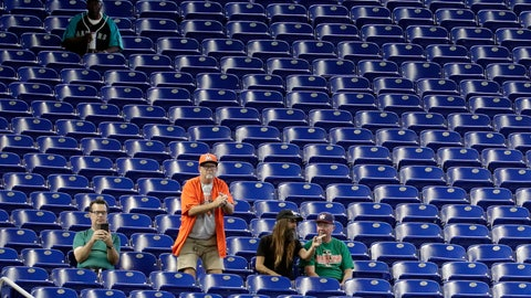 <p>               Fans watch a baseball game between the Miami Marlins and San Francisco Giants, Thursday, May 30, 2019, in Miami. Major League Baseball's average attendance of 26,854 is 1.4% below the 27,242 through the similar point last season, which wound below 30,000 for the first time since 2003. Baltimore, Cincinnati, Minnesota and Tampa Bay set stadium lows this year. Kansas City had its smallest home crowd since 2011, and Toronto and San Francisco since 2010. Miami and the Rays drew 12,653 Wednesday night _ combined. (AP Photo/Lynne Sladky)             </p>