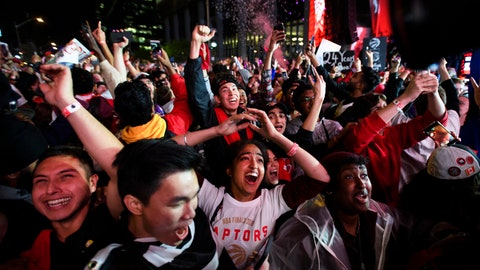 <p>               Fans celebrate in Jurassic Park outside Scotiabank Arena in Toronto as the Toronto Raptors defeated the Golden State Warriors 114-110 in Game 6 of basketball's NBA Finals in Oakland, Calif. (Nathan Denette/The Canadian Press via AP)             </p>