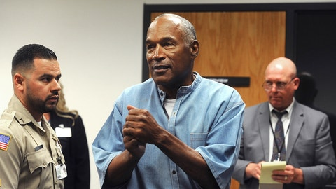 <p>               FILE - In this July 20, 2017, file photo, former NFL football star O.J. Simpson reacts after learning he was granted parole at Lovelock Correctional Center in Lovelock, Nev. Simpson got into a series of minor legal scrapes following his 1995 acquittal of murder charges in the deaths of his wife Nicole Brown Simpson and her friend Ronald Goldman. (Jason Bean/The Reno Gazette-Journal via AP, Pool, File)             </p>