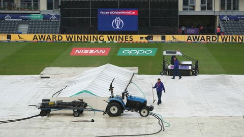 <p>               Ground staff work to clear water off the outfield prior to the Cricket World Cup match between Pakistan and Sri Lanka, at Bristol County Ground, in Bristol, England, Friday June 7, 2019. (David Davies/PA  via AP)             </p>