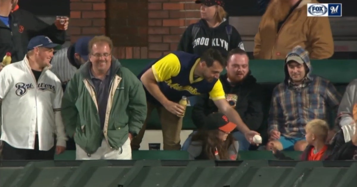 WATCH: Brewers fan in San Francisco catches game ball, immediately gives it to kid