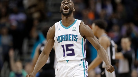 <p>               File-This March 26, 2019, file photo shows Charlotte Hornets' Kemba Walker (15) reacting after making a basket against the San Antonio Spurs during the second half of an NBA basketball game in Charlotte, N.C. A person with knowledge of the situation says Kemba Walker has told the Charlotte Hornets of his intention to sign with the Boston Celtics once the NBA's offseason moratorium ends July 6. Walker is planning to meet with the Celtics on Sunday, June 30, 2019, to discuss and likely finalize a four-year, $141 million deal, according to the person who spoke to The Associated Press on condition of anonymity because neither Walker nor the Hornets publicly revealed any details. (AP Photo/Chuck Burton, File)             </p>