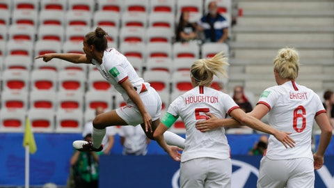 <p>               England's Nikita Parris, left, celebrates after scoring her side's opening goal on a penalty kick during the Women's World Cup Group D soccer match between England and Scotland in Nice, France, Sunday, June 9, 2019. (AP Photo/Claude Paris)             </p>