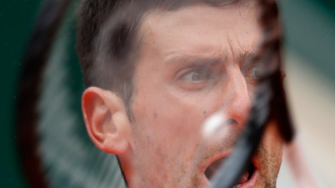 <p>               Serbia's Novak Djokovic plays a shot against Germany's Jan-Lennard Struff during their fourth round match of the French Open tennis tournament at the Roland Garros stadium in Paris, Monday, June 3, 2019. (AP Photo/Christophe Ena)             </p>