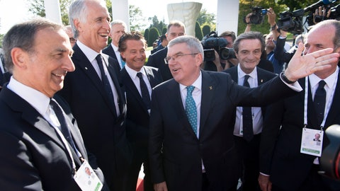 <p>               International Olympic Committee (IOC) president Thomas Bach, center, speaks with Italy's Under Secretary of State Giancarlo Giorgetti, right, Italy's Lombardy region President Attilio Fontana, second right, President of Veneto Region Luca Zaia, third left, Italian National Olympic Committee (CONI) president Giovanni Malago, second left, and the mayor of Milan Giuseppe Sala, left, before a meeting at the Olympic Museum, in Lausanne, Switzerland, Sunday, June 23, 2019. The host city of the 2026 Olympic Winter Games will be decided in Lausanne on Monday. (Laurent Gillieron/Keystone via AP))             </p>