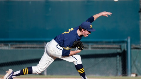 <p>               Michigan's Tommy Henry (47) throws to a UCLA batter during the first inning of an NCAA college baseball tournament super regional game in Los Angeles, Sunday, June 9, 2019. (AP Photo/Ringo H.W. Chiu)             </p>
