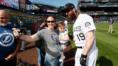 <p>               Colorado Rockies outfielder Charlie Blackmon, right, stops for a photo with Stephanie Archuleta, center, and her 20-month-old daughter Javielyn during a fan photo promotion before a baseball game against the Toronto Blue Jays, Saturday, June 1, 2019, in Denver. (AP Photo/David Zalubowski)             </p>
