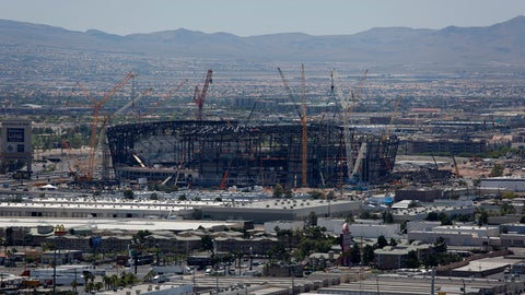 <p>               Construction cranes surround the future NFL Raiders football stadium Tuesday, June 4, 2019, in Las Vegas. The Las Vegas Bowl is moving to the new stadium next year, and will feature teams from the SEC or Big Ten conferences against a Pac-12 contender. (AP Photo/John Locher)             </p>