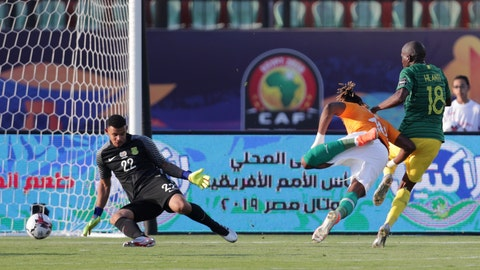 <p>               Ivory Coast's Jonathan Kodjia, center, scores his side's opening goal during the African Cup of Nations group D soccer match between Ivory Coast and South Africa in Al Salam Stadium in Cairo, Egypt, Monday, June 24, 2019. (AP Photo/Hassan Ammar)             </p>