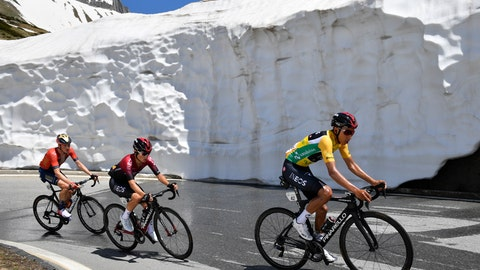 <p>               Rohan Dennis from Australia of Bahrain-Merida Pro Cycling Team, left, and Egan Bernal from Colombia of Team Ineos, right, climb the Nufenen pass during the ninth and final stage, a 101.5 km race with start and finish in Goms, Switzerland, at the 83rd Tour de Suisse UCI ProTour cycling race, on Sunday, June 23, 2019. (Gian Ehrenzeller/Keystone via AP)             </p>