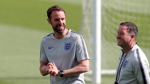 <p>               England manager Gareth Southgate, left, smiles during a a training session at their training ground in Guimaraes, Portugal, Saturday, June 8, 2019. England will play Switzerland in the UEFA Nations League third place soccer match Sunday. (AP Photo/Luis Vieira)             </p>