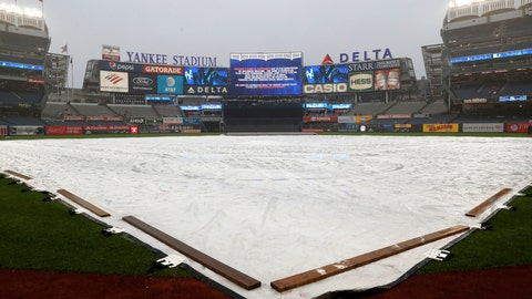 <p>               The field is covered by a tarp as rain falls before a baseball game between the New York Yankees and the New York Mets was postponed due to inclement weather, Monday, June 10, 2019, in New York. (AP Photo/Kathy Willens)             </p>