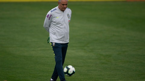 <p>               Brazil's national soccer team coach Tite kicks the ball during a practice session at the Granja Comary training center ahead the Copa America tournament in Teresopolis, Brazil, Sunday, June 2, 2019. (AP Photo/Leo Correa)             </p>