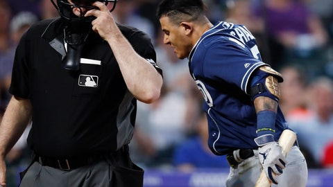 <p>               San Diego Padres' Manny Machado, right, throws down his helmet as he yells at home plate umpire Bill Welke, who had called Machado out on strikes during the fifth inning of the team's baseball game against the Colorado Rockies on Saturday, June 15, 2019, in Denver. (AP Photo/David Zalubowski)             </p>