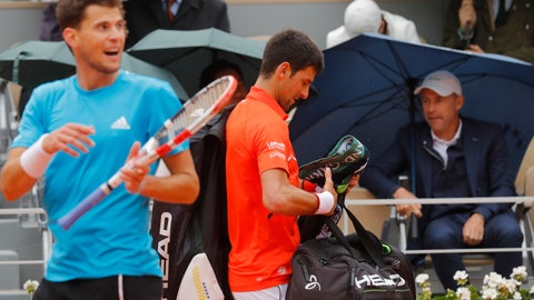 <p>               Austria's Dominic Thiem, left, and Serbia's Novak Djokovic head to the locker room as rain interrupted their semifinal match of the French Open tennis tournament at the Roland Garros stadium in Paris, Friday, June 7, 2019. (AP Photo/Michel Euler)             </p>